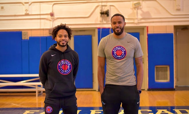 Holy Cross Hall of Famer Kevin Hamilton, right, and his brother, Kieran, are co-founders of Hamilton Hoops Academy.