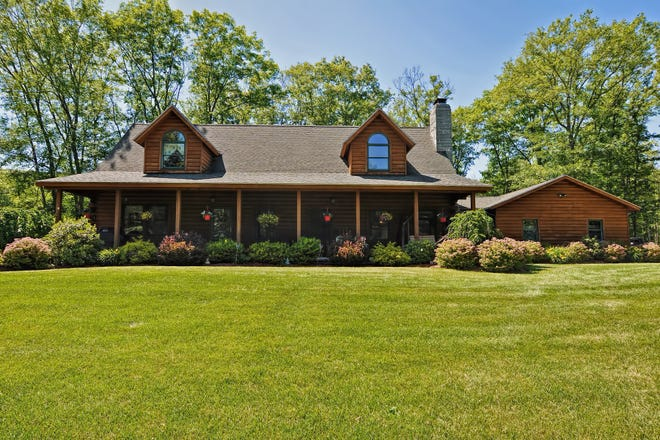 This 2,571-square-foot log house at 2692 Greenwich Road lists for $1,250,000. View a photo gallery on telegram.com.