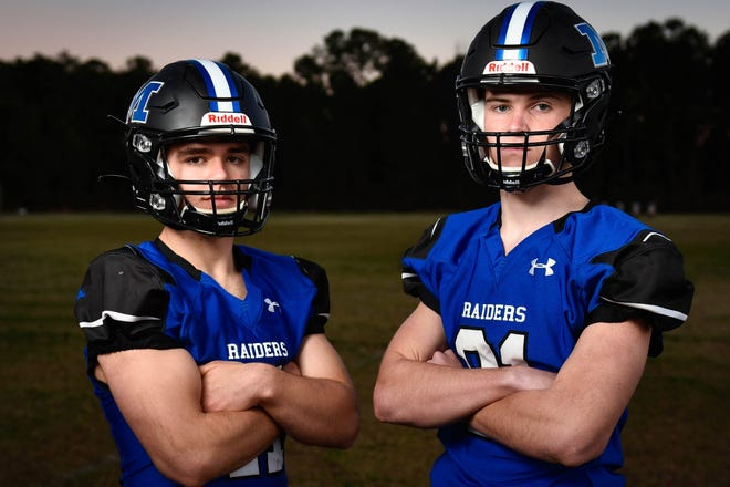 Midway Raiders quarterback Wyatt Holland, left, and receiver Lane Baggett hooked up for 102 yards and three touchdowns in last week's season-opening 53-13 win over Hobbton. Their chemistry isn't a coincidence. Holland and Baggett are first cousins with a close family bond.