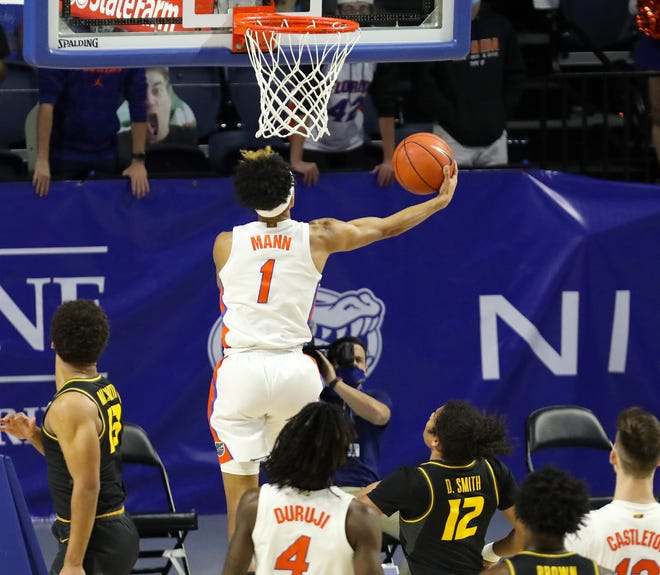 Florida guard Tre Mann scoops under the basket and scores on the backside Wednesday against Missouri at Exactech Arena.