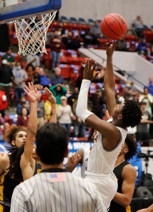 Santa Fe's Willie Lewis scores the game-winner in the final seconds Thursday against West Nassau in the FHSAA Boys State 4A Semifinal basketball game at the RP Funding Center in Lakeland. [Calvin Knight/Special to The Sun]