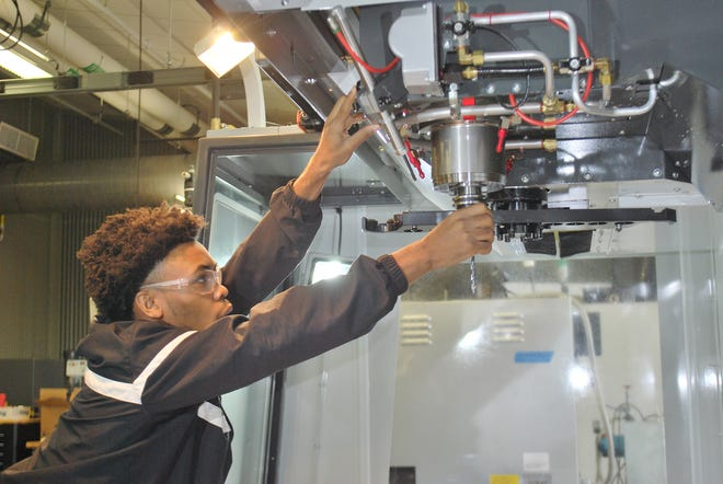 A student is shown in the Center for Integrated Manufacturing at Southern Union Community College in Opelika. Gadsden State Community College hopes to build a similar facility.