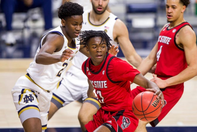 North Carolina State's Cam Hayes (3) gets pressure from Notre Dame's Trey Wertz (2) during the first half of an NCAA college basketball game Wednesday, March 3, 2021, in South Bend, Ind. (AP Photo/Robert Franklin)