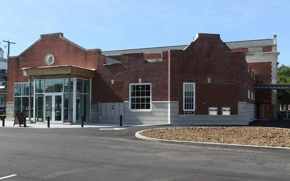 The addition to the Tuscarawas County Library, which includes a drive-up window, was highlighted by New Philadelphia Mayor Joel Day.