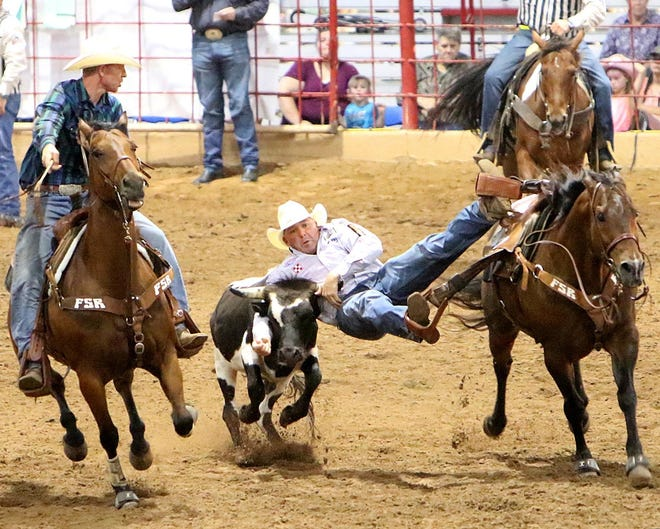 Will Lummus of West Point, Mississippi, rides in the steer wrestling event of the 2018 Old Fort Days Rodeo at Kay Rodgers Park. The rodeo committee announced Thursday the event would return on Memorial Day 2021 after a lapse in 2020 due to the COVID-19 pandemic.