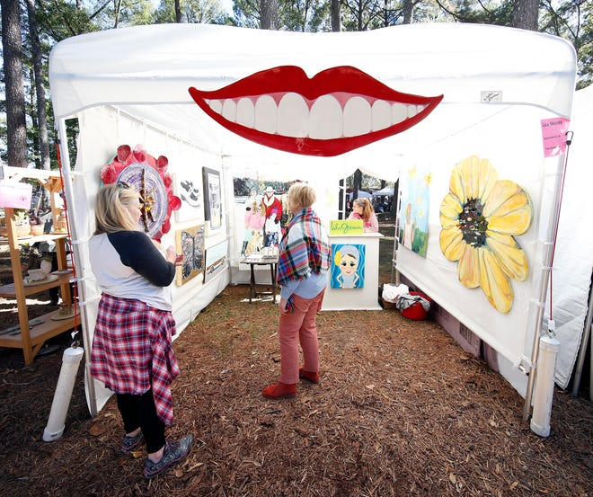 Guests visit the booth of Lila Graves at the 44th Annual Kentuck Festival of the Arts on Saturday Oct. 17, 2015 in Northport, Ala. staff photo | Robert Sutton