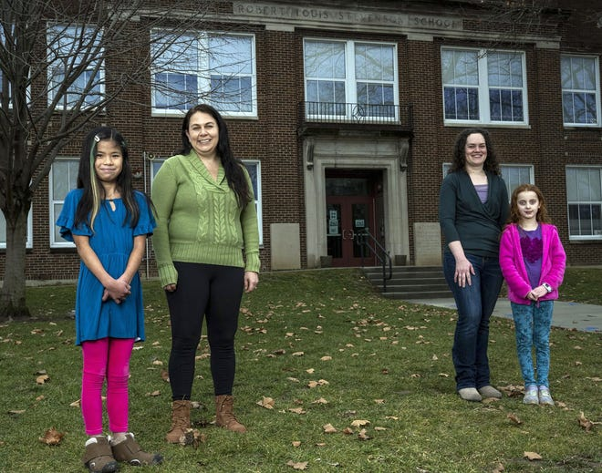 Falyn Sauer, 11, and her mother, Jen Palmer (on the left) have become close friends with Katya Harfmann and her daughter, Matilda Hopkins, 7 (right). The four, pictured in front of Stevenson Elementary School on Feb. 28, have bonded over a rare medical condition the two children have. Both Falyn and Matilda have vascular Ehlers-Danlos syndrome. Palmer, a fourth-grade teacher at Edison Intermediate Larson/Middle School, teaches Matilda's older sister.