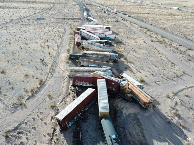 A BNSF train sits derailed east of Ludlow in the Mojave Desert on Wednesday, March 3, 2021.