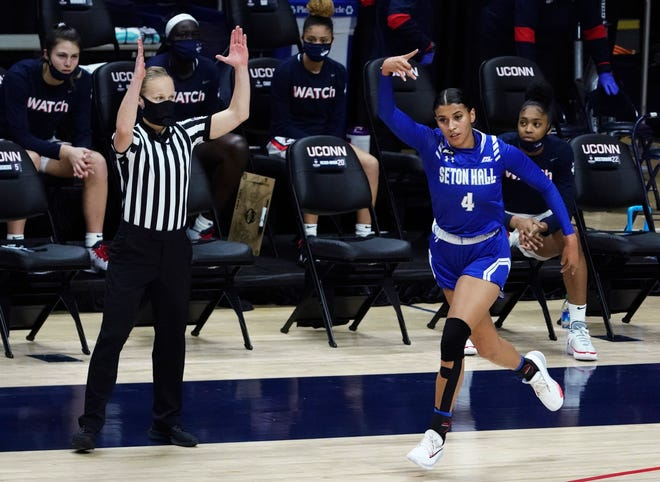 Seton Hall guard Andra Espinoza-Hunter gestures after a 3-point basket against the Connecticut Feb. 10