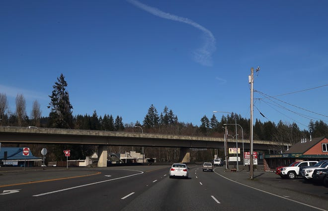 Cars travel along Highway 16 in Gorst on Wednesday, March 3, 2021.