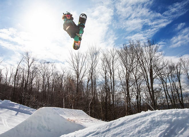 Miles Fallon rides during the Red Bull Slide In Tour at Loon Mountain in Lincoln NH, USA on 12 March, 2020. Fallon is part of the Red Bull-sponsored snowboarder team touring Vermont in early March 2021.