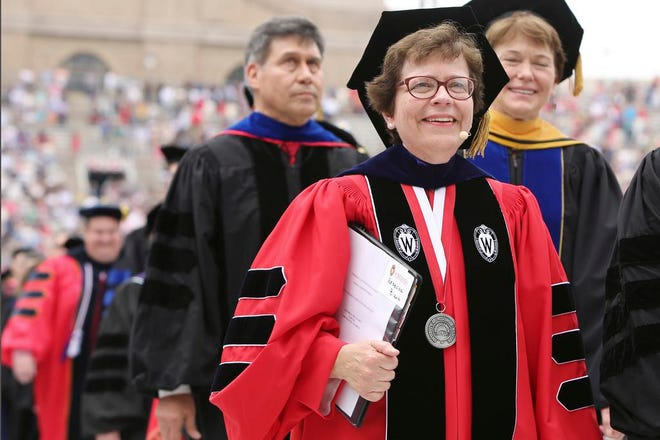 In this May 16, 2015 file photo, Chancellor Rebecca M. Blank, walks in a procession at the start of the University of Wisconsin-Madison spring commencement ceremony in Madison, Wis. A normal fall semester at the University of Wisconsin-Madison will depend on the pace of vaccinations for faculty, staff and students,  Blank said Wednesday, March 3, 2021.