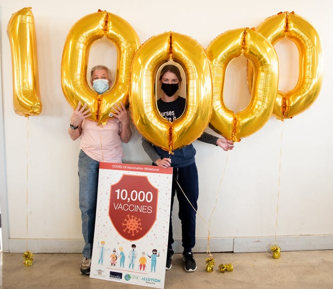Benefis nurse Kayla VanderKooy and Great Falls resident Tanya Schaefer celebrate Schaefer recieving the 10,000th vaccine administered at the Cascade County Community COVID-19 Vaccination Clinic.
