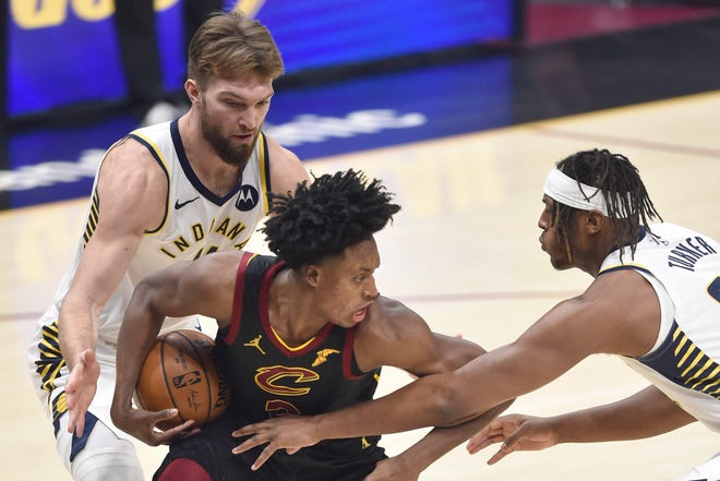 Indiana Pacers forward Domantas Sabonis (11) and center Myles Turner (33) defend Cavaliers guard Collin Sexton (2) in the first quarter of the Pacers' 114-111 win Wednesday night at Rocket Mortgage FieldHouse. [USA TODAY Network]