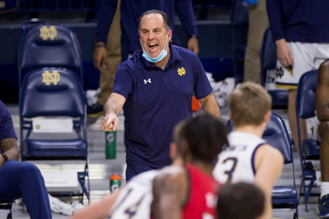 Notre Dame head coach Mike Brey directs players during the first half of Wednesday's game against North Carolina State.