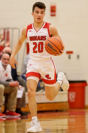 Twin Lakes' Clayton Bridwell (20) dribbles during the second quarter of an IHSAA boys basketball sectional game, Wednesday, March 3, 2021 in Monticello.