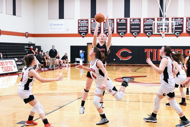 Liberty Union's Caroline Berlekamp shoots the ball over Circleville's Morgan Blakeman Wednesday night at Circleville. The Tigers prevailed 57-52 in overtime. -Jamie Potts/Eagle Gazette