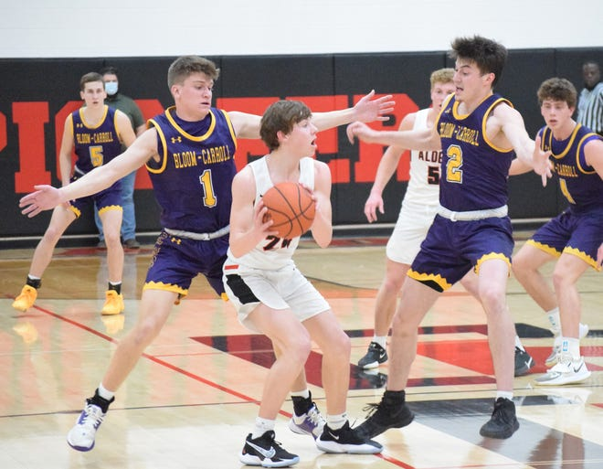 Bloom-Carroll's Joe Luckhaupt and Ryan Williams trap Jonathan Alder's Payton Heiss during their Division II district semifinal Wednesday night. The Bulldogs fell short, 45-27.