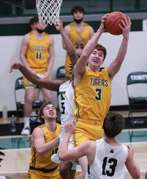 St. X's Ayden Mudd (3) grabs a rebound against Trinity during their game at the Trinity High School in Louisville, Ky. on March 3, 2021.