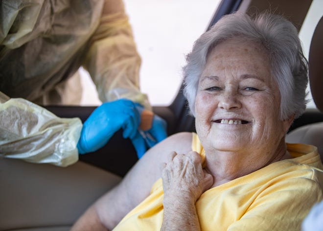 Karen Davidson receives her second dose of the COVID-19 vaccine at Greater Imani Church in Memphis, Tenn., on Thursday, March 4, 2021.