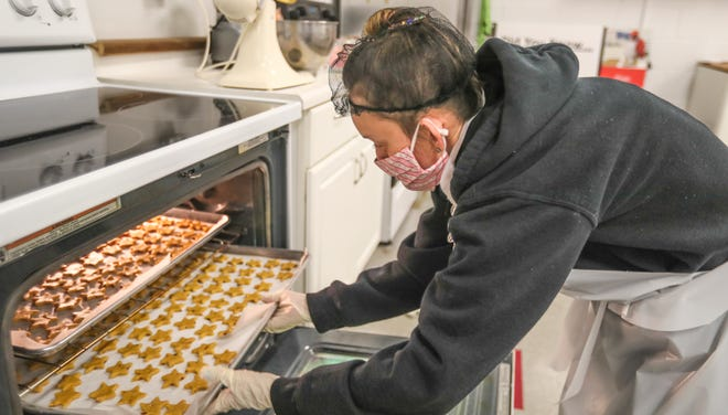 "A program participant places the dog treats in the oven on Wednesday, March 3, 2021, at Eisenhower Center, Inc., in Milwaukee. ""I like to work and do my job,"" said Maeghan, who preferred to use just her first name for privacy reasons. ""Just because I have a disability doesn't mean I'm unable to work and help people."""