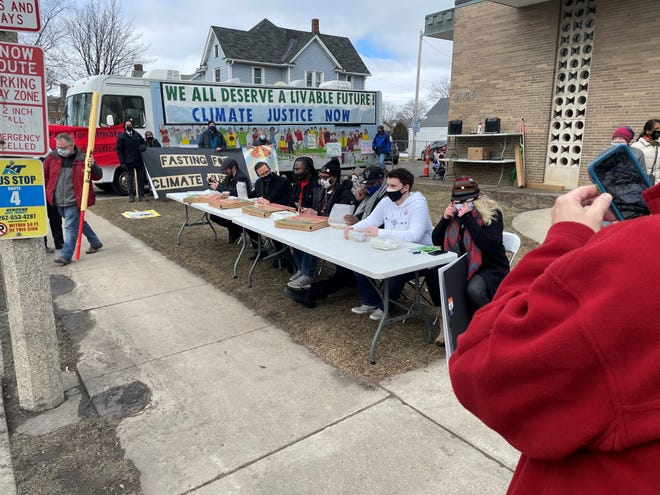 "The ""Wisconsin Seven"" take their final bites of food prior to a 22-day fast for climate justice on Thursday, March 4, in Kenosha."