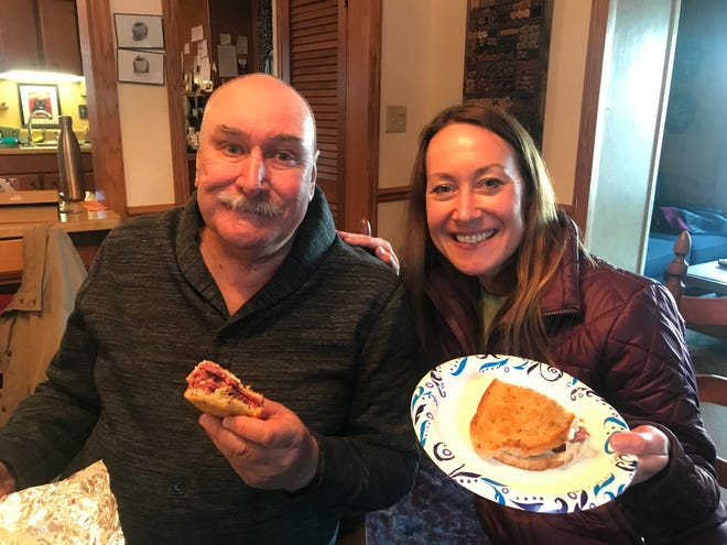 Mike Frank and Amanda DeSua with one of the sandwiches in their quest to find the Milwaukee area's best reuben.