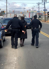 In this submitted photo, Sandra B. Cunningham is arrested on Culver Avenue in Jersey City on March 4, 2021.