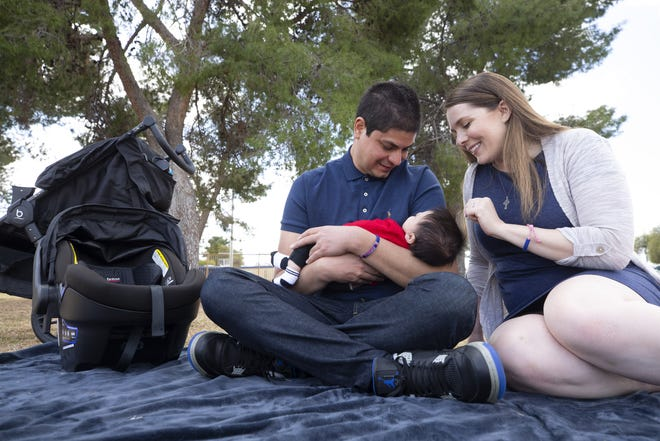 Bryan and Jacqueline Martinez hang out with their 9-week-old son, Maddox, at Roadrunner Park in Phoenix on March 4, 2021. Jacqueline and Bryan lost a previous child in 2019, when at 21 weeks pregnant they received the news that their child, Isabell, had a genetic disorder and would not survive outside the womb.