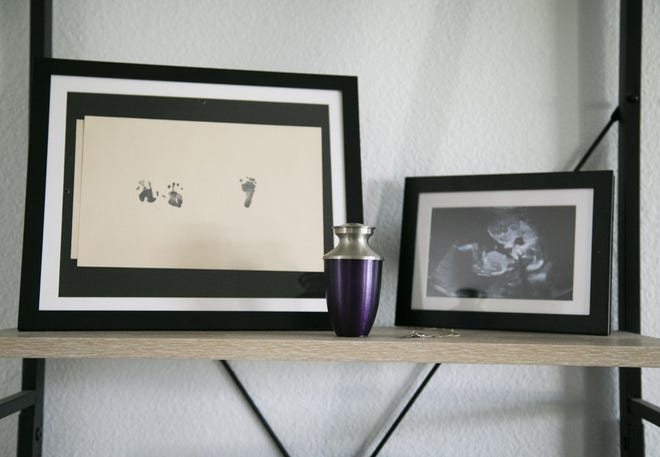 Arkansas lawmakers voted to require a woman undergoing an abortion to first view an ultrasound, the latest restriction to advance in a state that has already enacted an outright abortion ban. This image shows an urn containing the remains of Isabell Martinez, who died at 21 weeks in utero, sits on a shelf alongside her handprints and a footprint and an ultrasound photo in the home of her parents, Jacqueline and Bryan Martinez, in Phoenix on March 4, 2021. Isabell had a genetic disorder and would not survive outside the womb. Her parents made the decision to have a late-term abortion.