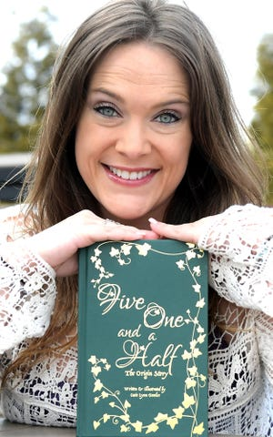 "Casie Fowler poses with her book ""Five One and a Half"" at her New Freedom home Thursday, March 4, 2021. The book is a coming-of-age novel about a girl with special powers. It's her first novel. Bill Kalina photo"