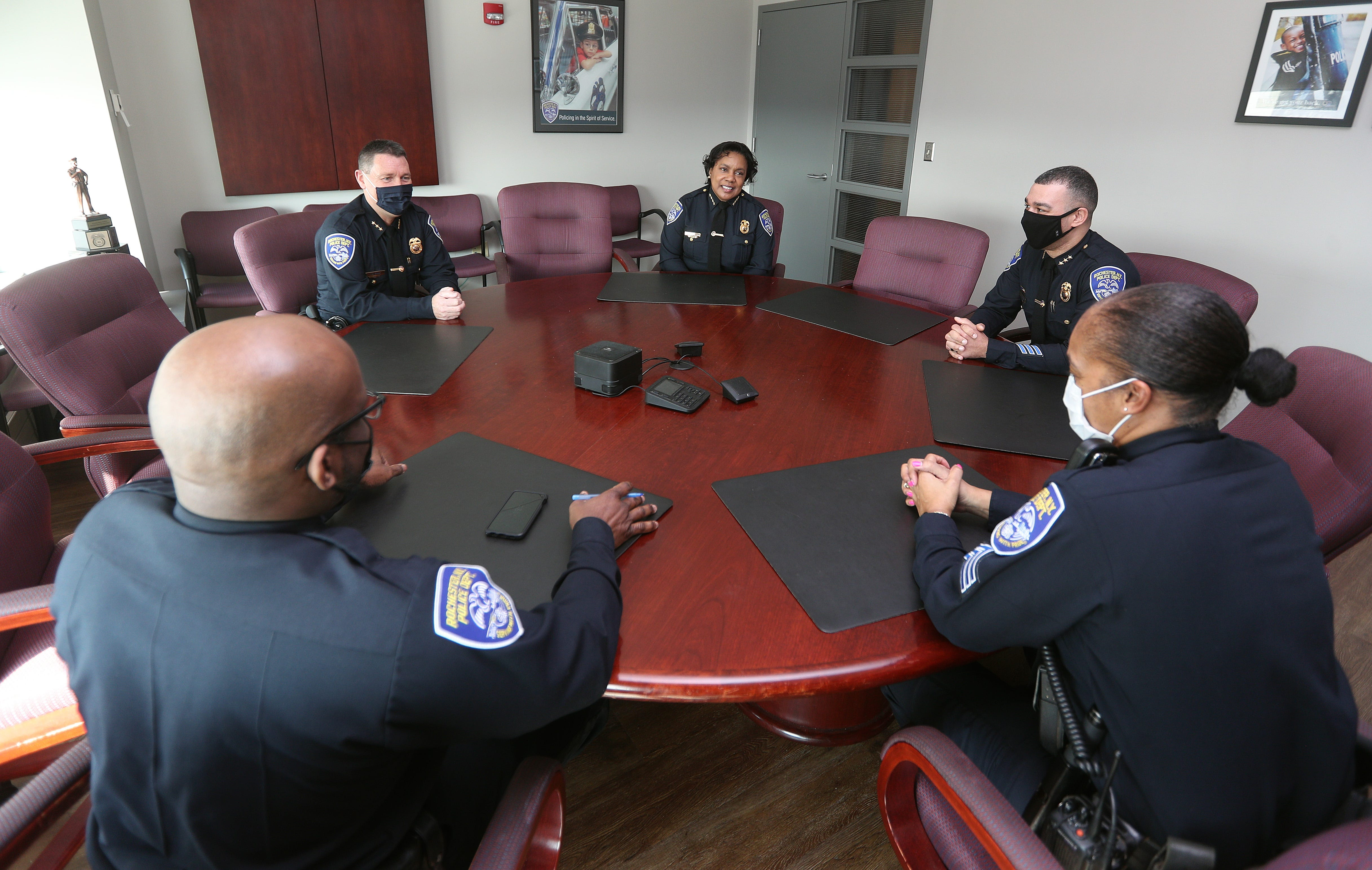 Rochester, New York Police Chief Cynthia Herriott-Sullivan  (center rear) meets with some of her command staff in a conference room outside her office.