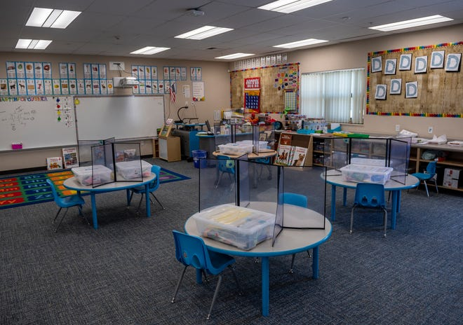 Plexiglass barriers are placed on top of four tables inside a transitional kindergarten classroom at Arroyo Seco Academy in Greenfield, Calif., on Wednesday, March 3, 2021.