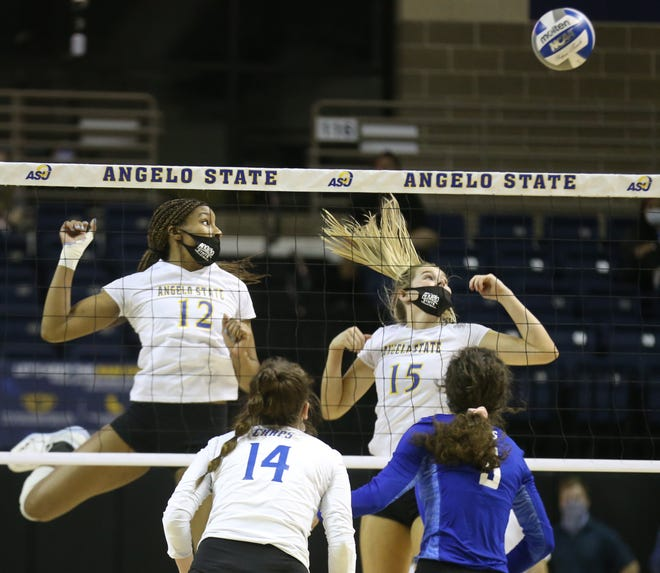 Angelo State University's Baleigh Allen, 12, and Elsa Lamphere, 15, watch a kill attempt by Lubbock Christian go over the net during a Lone Star Conference match at the Junell Center on Wednesday, March 3, 2021.