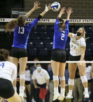 Angelo State University's Alyssa Meyer, 23, goes up for an attack against Lubbock Christian during a Lone Star Conference match at the Junell Center on Wednesday, March 3, 2021.
