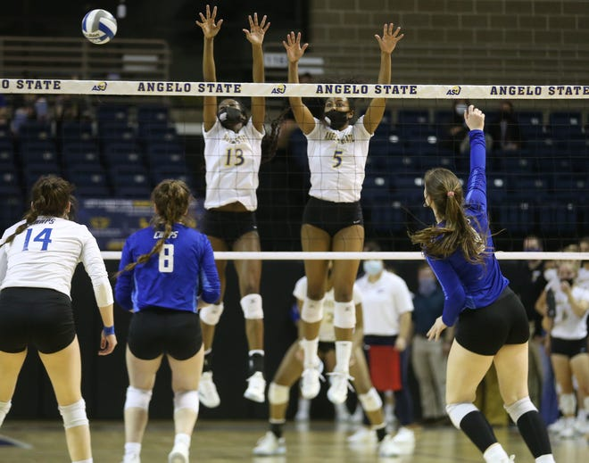 Angelo State University's Grace White, 13, and Nailah Gordon, 5, try to make a block against Lubbock Christian during a Lone Star Conference match at the Junell Center on Wednesday, March 3, 2021.