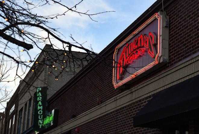 The neon sign lights up as the suns sets Wednesday, March 3, 2021, at Minerva's in Sioux Falls.