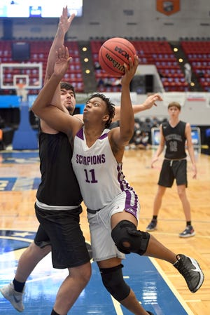 Crossroads Academy's Elgin Outley shoots against Central during their Class 1A semifinal in the FHSAA State Championships at The RP Funding Center in Lakeland Wednesday