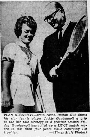 Jan. 17, 1965 Irvin coach Dalton Hill shows his star tennis player Jackie Guadagnoli a grip as the two talk strategy in a practice session.