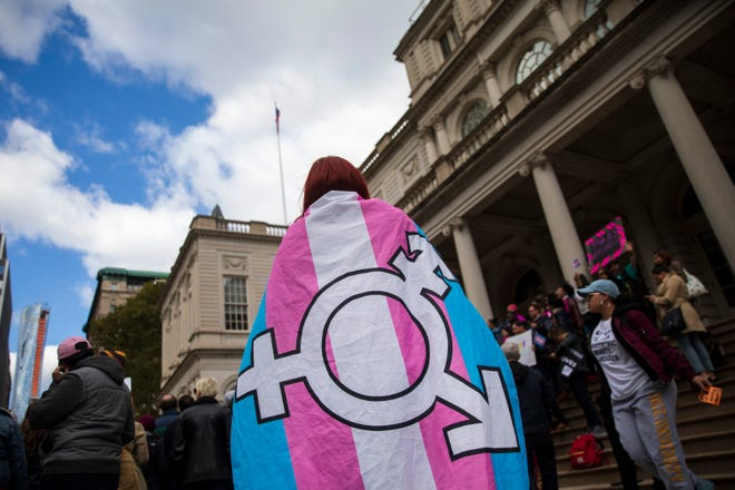 LGBTQ activists and their supporters rally in support of transgender people on the steps of New York City Hall, October 24, 2018 in New York City.