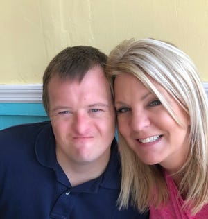 Nick Revels, who has Down syndrome, poses for a picture with his mother, Debbie Revels, executive director of the Down Syndrome Association of Jacksonville. The group was among four Florida organizations that waged the #AShotAtTheShot campaign in early 2021 to lobby state health officials to grant COVID-19 vaccination priority to adults with Down syndrome.