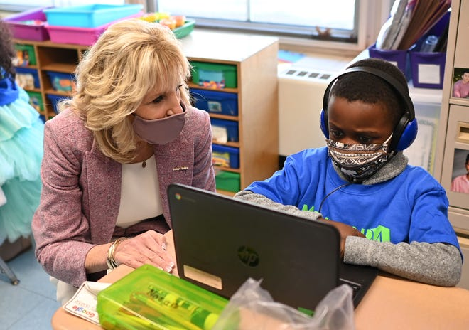 First lady Jill Biden speaks with a student as she tours Benjamin Franklin Elementary School,  March 3, 2021 in Meriden, Ct.