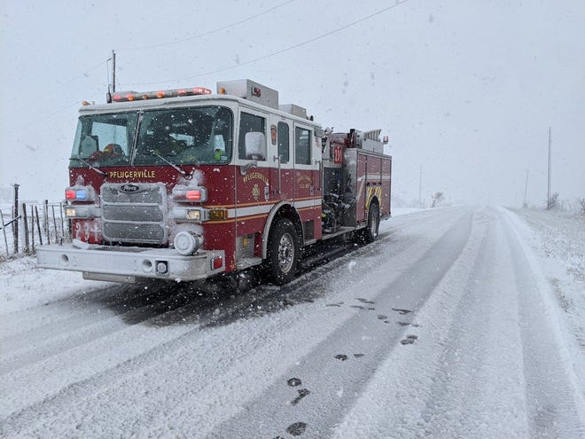 A Travis County ESD No. 2 fire engine makes its way to a call through the snow during the severe winter storm in February. District officials say it ran more than 900 calls the week of the storm, roughly equivalent to the call volume it experiences in a month.