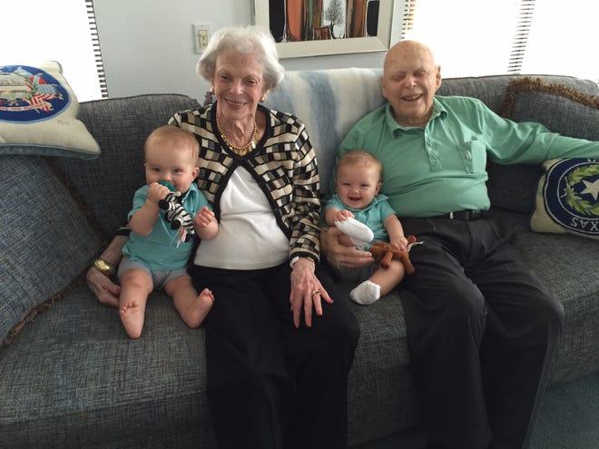 Marilyn Schwartz and Babe Schwartz sit with great-grandsons William Schwartz, left, and Jackson Schwartz, center.