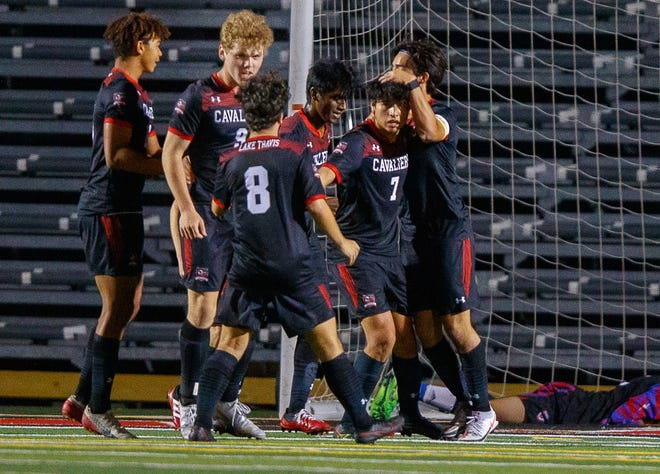 Lake Travis' Alex Bethke (9) and his teammates celebrate after he scored his second goal against visiting Westlake in a District 26-6A game Thursday.