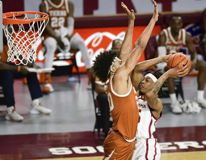 Texas forward Jericho Sims contests a shot from Oklahoma's Alondes Williams during the first half of the Longhorns' 69-65 win in Norman, Okla., on Thursday night.