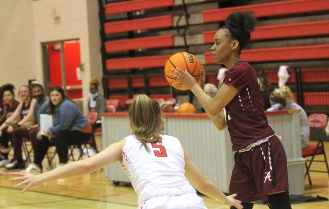 Ardmore's Khalayah Willis looks for an open teammate Thursday night. Willis finished with a game-high 17 points to lead the Lady Tigers to a 67-39 win over Duncan during the Class 5A Area Tournament at Carl Albert.