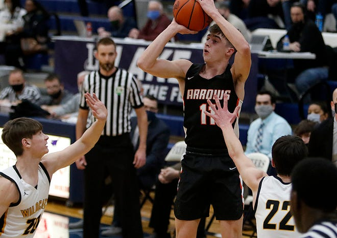 Ashland's Eli White (11) puts up a shot against Sylvania Northview during the Arrows' 76-64 loss Thursday at Lake High School.