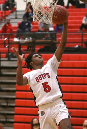 Aliquippa's Deandre Moye (5) goes for a layup during the first half of the 2A WPIAL Playoffs against New Brighton Thursday night at Aliquippa High School.