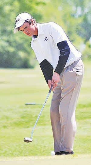 Andrew Lehman focuses on a short shot during his golf days in the mid-2010's for Bartlesville High School. (Mike Tupa/Examiner-Enterprise)